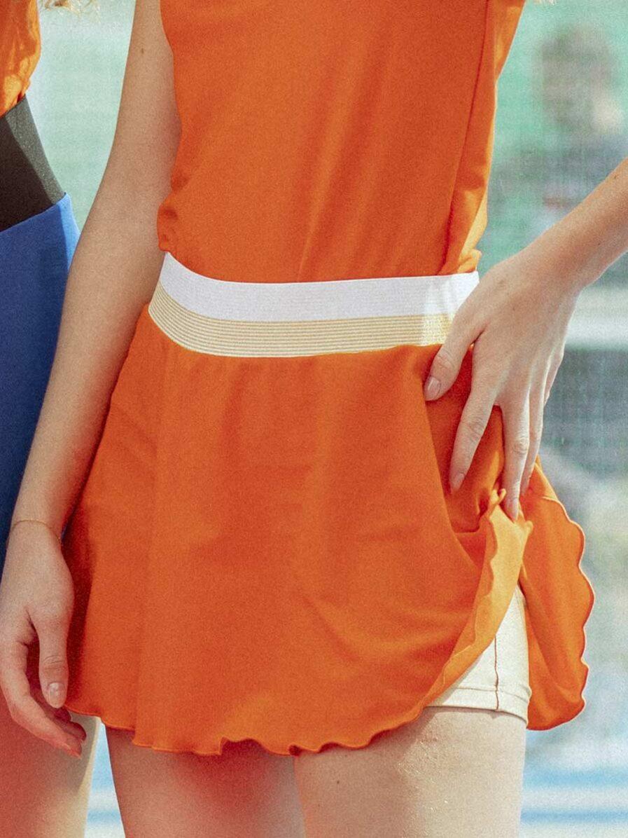 Gonnellino sportivo arancione da Padel